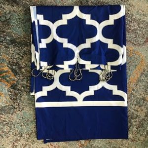 Royal blue shower curtain with silver hooks